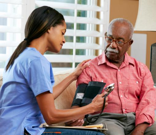 companion checking blood pressure