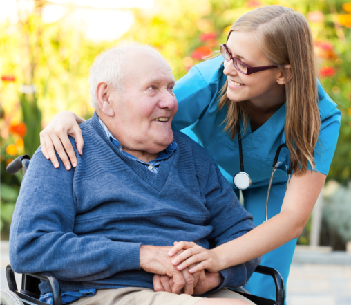 elderly in a wheel chair with companion