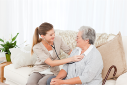 elderly woman with health aide